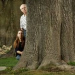 Residents on Maplewood Place and Brentwood Avenue are trying to save the large ash trees that line their streets. Home owners, from left, April Glatzel, 42, Vern Goodwalt, 69, and Joe Deem, 54, are helping lead the charge to save the trees, which include this one that is trees more than 50 years old.