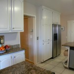 Another view of kitchen showing even more cabinetry and granite counter tops!