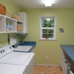 Huge custom-built laundry room with tons of storage and space to hang clothing too.