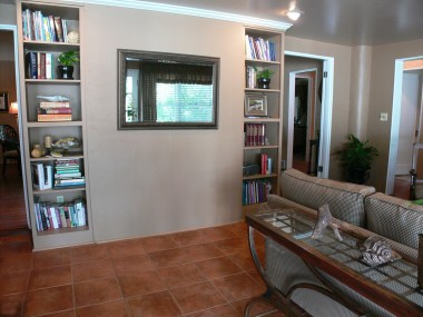 View of bookshelves in family room (living room fireplace is behind this wall).