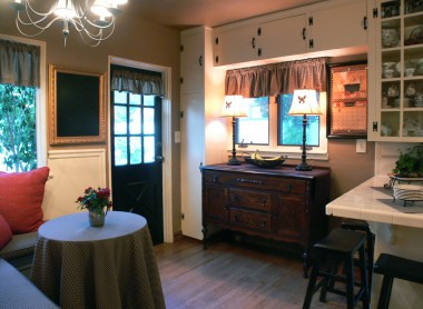 Alternate view of kitchen with breakfast bar to the right, lots of cabinetry, and nook to the left.