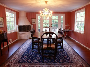 Large formal dining room with hardwood floors, crown moulding and newer French doors overlooking beautiful backyard.
