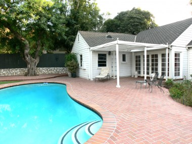 Alternate view of brick patio and pool that was re-plastered and re-tiled in 1992!