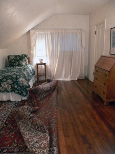 Upstairs bedroom -- area rug was pulled back just to show how beautiful the hardwood floors are!